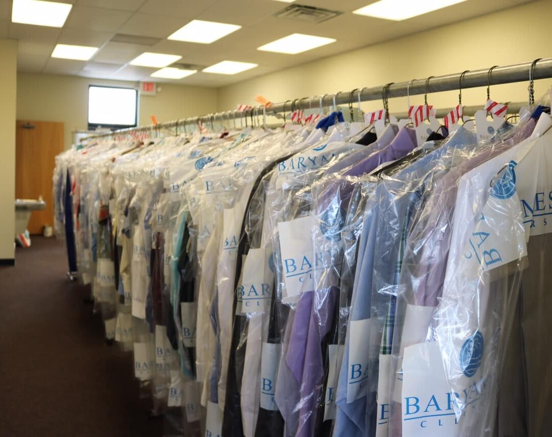 Rack of dry cleaning clothes