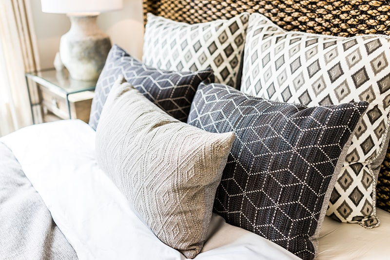 Closeup of new bed comforter with decorative pillows